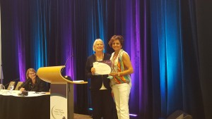 Myrna Doumit (right) receiving People's Choice Poster Award from Linda Krebs (left) at ICCN 2015.